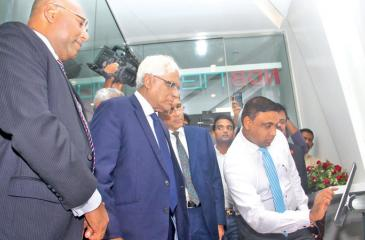 Central Bank Governor, Dr. Indrajith Coomaraswamy and senior bank officials observe the system   Pix: Chaminda Niroshan