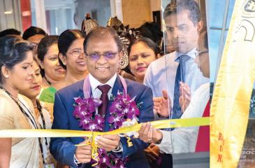 The BOC's CEO and General Manager Senarath Bandara opens the Milagiriya branch. Deputy General Manager Retail Banking Range 1 and Range 2 - D.M.L.B. Dassanayake and Deputy General Manager Support Services W.I. Hettihewa look on.