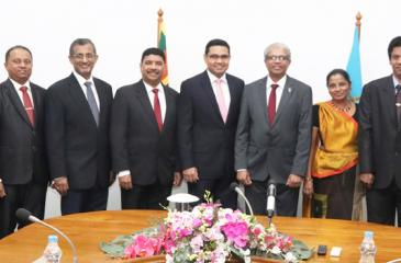 Commercial Bank's Chief Operating Officer Sanath Manatunge (fifth from left), SLPA Managing Director Captain Athula Hewavitharana and representatives of the two organisations after signing the agreement.