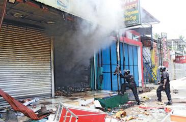 Violence in Digana last year. Pic: Lake House Media Library