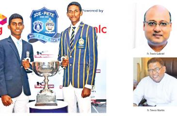 Ashain Daniel the captain of St. Joseph's College (left) and Ranmith Jayasena the captain of St. Peter's College hold the Fr. Maurice Legoc Cup they'll play for