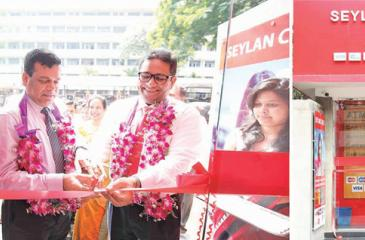 Seylan Bank Deputy General Manager, branches, Chitral de Silva opens the newly set up Godakawela branch.