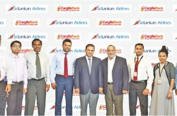 SriLankan Airlines team together with Cargills Bank team after signing the agreement.
