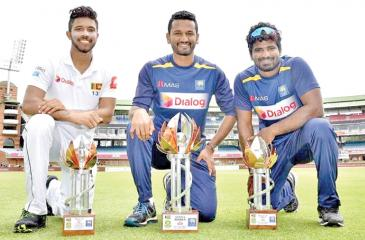 Man of the match Kusal Mendis (left), captain Dimuth Karunaratne and Kusal Perera the Man of the Series genuflect with their trophies