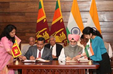 Signing of the MoU by High Commissioner of India to Sri Lanka Taranjit Singh Sandhu and Secretary, Ministry of Development Strategies and International Trade, S. T. Kodikara at Temple Trees while Prime Minister Ranil Wickremesinghe and Minister of Development Strategies and International Trade, Malik Samarawickrema look on.