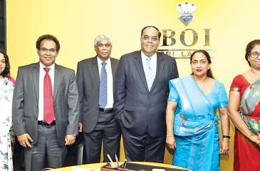 Hutch and BOI officials after signing the MoU.