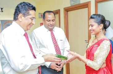 From left: Lanka Hospitals Chairman Dr. Sarath Paranavitane and Group CEO Dr. Prasad Medawatte being welcomed at the Lanka Hospitals' Staff Awards ceremony.
