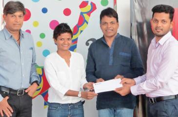 Wurth officials present the sponsorship package to Jayanthi Kuru-Utumpala and Johann Peries.