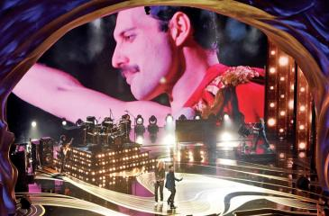 An image of the late Freddie Mercury is projected onto a screen while Queen + Adam Lambert perform to start the show