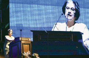 Former President Chandrika Bandaranaike Kumaratunga speaking at the ceremony to mark Minister Mangala Samaraweera's 30 years in parliamentary politics at the BMICH
