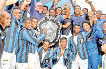 The victorious S. Thomas' College team celebrate winning the DS Senanayake Shield after beating Royal College in the 140th Battle of the Blues match at the SSC ground yesterday (Pix by Sulochana Gamage and Saman Mendis)