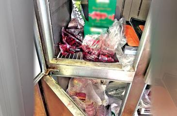The refrigerator with mixed food items