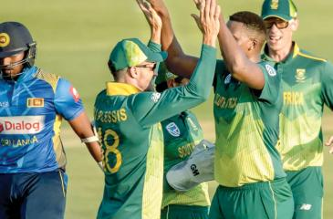 South African bowler Lungi Ngidi celebrates taking the wicket of Avishka Fernando with his captain Faf du Plessis in the fifth and final ODI yesterday