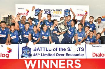 The triumphant cricketers of St. Joseph's College Johanne de Zilva, Sheran Fonseka, Shevon Daniel, Dineth Jayakody, Dilesh Perera, Dunith Wellalage, Sachintha Ravindu, Lakshan Gamage, Ashen Daniel, Shalinda Seneviratne and Ashan de Alwis celebrate with the Fr. Peter Pillai Shield after beating St. Peter's College in their Battle of the Saints One-Day match at the SSC ground yesterday