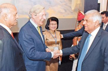 Prime Minister Ranil Wickremesinghe greets Asia-Europe Political Forum (AEPF) co-chairperson Geoffrey Van Orden at the third meeting of the AEPF at the Hilton Hotel yesterday.
