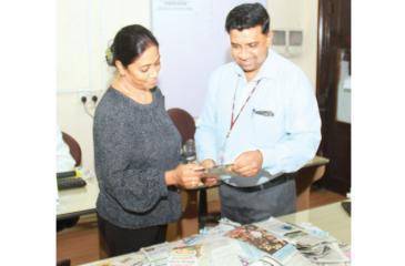 Samantha Jayaweera (right) Manager Production planning and Manjula Fernando, Senior News Reporter Sunday Observer, selecting the winners at Lake House office.