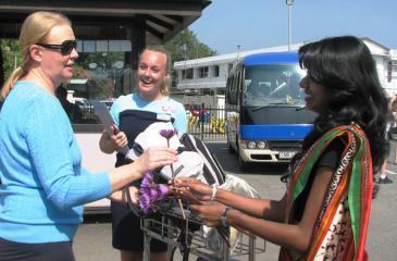 An employee of Aitken Spence Travels welcomes a tourist.