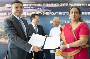 Director General for the Board of Investment of Sri Lanka, Mrs. Champika Malalgoda presents the agreement of occupancy of the Board of Investment of Sri Lanka office at the Hambantota International Port, to Chief Executive Officer for HIPG,   Ray Ren.