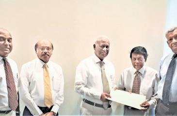 The exchange of the MoU. From left: Dr. Santush Perera, Prof. Lal Chandrasena,  Jayantha Dharmadasa, Jay Liyanage and Asoka Wickremasinghe.