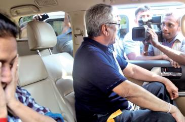 Beleagured former Defence Secretary Gotabaya Rajapaksa speaks to the media outside the Bandaranaike International Airport upon his return to Colombo from Los Angeles on Friday, as his wife Ioma Rajapaksa looks on (Pic By Sulochana Gamage)