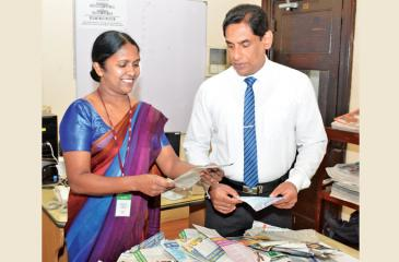 Selecting the winners of the Readers Coupon draw No. 22 of the 'Observer School Cricketer' by D.M. Samantha Karunasekera (right) Managing Editor Government Relations Department ANCL and Amitha Kanthilatha, Head of Human Capital. Picture by Sarath Peiris.