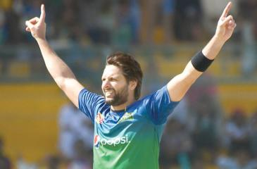 Afridi in his characteristic pose after taking a wicket