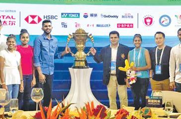 The Sri Lanka badminton team posses with the Sudirman Cup. From left: Buwaneka Gunatillleka, Kavidi Sirimannage, Dilmi Dias, Sachin Dias, Mahinda Dadampe Gamage (Manager), Thilini Hendahewa, Tony Wahyudi (coach) and Dinuka Karunaratne