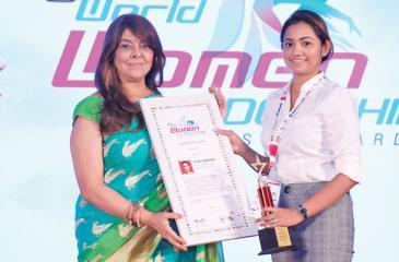 Diluni Jayasekera (on right) receives her award.