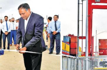 Sri Lanka Ports Authority Chairman Kavan Rathnayake (on right) and CICT CEO Jack Huang open CICT's Dangerous Goods Storage Facility.