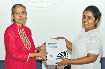 Shyamala Pushpanathan receiving her prize and Anuradha Nilmini Kumari' husband being handed his prize