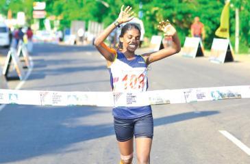 PB Gayani winning the women's walking race