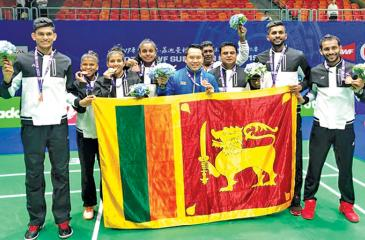 The Sri Lanka badminton team which became group champions pose with their medals. From left: Buwaneka Gunatilleka, Kavidi Sirimannage, Thilini Hendahewa, Dilmi Dias, Tony Wahyudi (coach), Mahinda Gamage, Sachin Dias and Dinuka Karunaratna