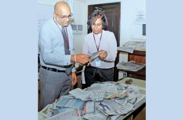 Manager Sales Field Operations, Shantha Pushpakumara (left) and Chief Librarian Rasika Nelanthi Liyanagama, selecting the Readers Coupon draw winners of Coupon No. 27 at Lake House. Pic: Saliya Rupesinghe