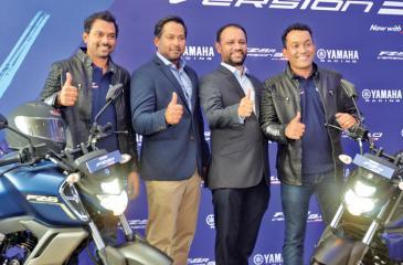 Deputy General Manager, Yamaha, Z. Ziyawudeen, the Brand Ambassadors of the two motorbicycles, Bathiya and Santhush and Director Passenger Vehicles, AMW, Yohann de Soyza at the launch.