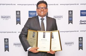 KWA Architects, Partner Thilan Koththigoda with the awards.