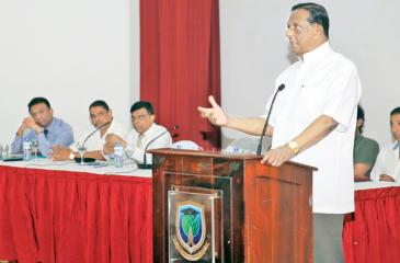 Minister John Amaratunga addresses the meeting.