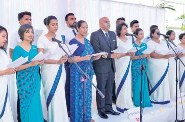 The staff sing Bhakthi Gee