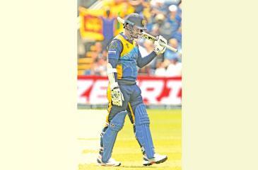 Sri Lanka's captain Dimuth Karunaratne celebrates after scoring a half-century- AFP