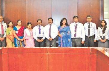 Officials of Central Bank and DFCC Bank at the agreement signing ceremony.