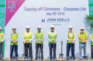 Officials at the topping off event. Senior General Manager, Access Engineering, Srimal Fernando, Project Director, HKN, T. H. Kim, President, Property Sector, John Keells Holdings, Suresh Rajendra, Deputy Chairman, John Keells Holdings, Gihan Cooray, Chairman, John Keells Holdings, Krishan Balendra, Project Manager/Engineer, Balmond Studio, Jeremy Mayhew, Operations Manager, Balmond Studio, Peter McDonald and Senior Project Manager, HKN, J. J. Park.