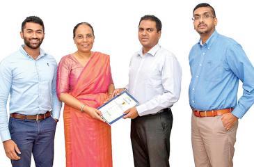 From left - Rifas Mohommed, Tamara Dharmakirti Herath Fintrex CEO, Isira Perera, Chief Operating Officer of PickMe, Lakmal Weerasuriya, Head of Corporate Sales of PickMe.