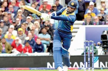 Dimuth Karunaratne drives a ball during his innings of 97 against Australia in Sri Lanka's World Cup match at the London Oval yesterday  Pic: Kamal Jayamanne