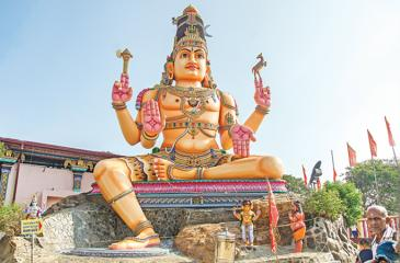 The front view of the magnificent Koneshwaran Temple with a gigantic statue of Lord Shiva