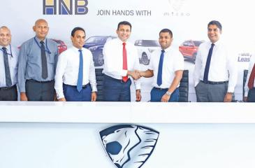 From left: HNB Leasing Executive - Business Development, Mahesh Ratnayake, HNB, Assistant Manager – Leasing, Roshan De Silva, HNB Senior Manager – Leasing, Niluka Amarasinghe, HNB Head of Personal Financial Services, Kanchana Karunagama, Micro Cars Director Marketing, Ruvindu Guneratne, Micro Cars General Manager, Dhammika Gunawardena and Micro Cars Head of Sales, Prasad Malalasekara after the signing of the agreement.
