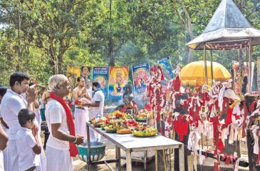 The devotees offer Pooja Vatti (baskets) with fruits and sweetmeats to God Skanda at Kebilitta shrin