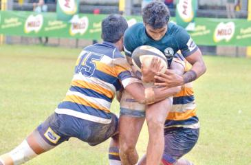 Isipathana player Yohan Ratnaweera is stalled by the Peterite defence  (Pic: Saman Mendis)