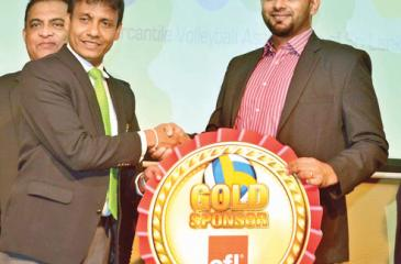 Director Corporate HR MAS Holdings Kolitha Gunetilleke hands over the Platinum sponsorship for the Mercantile Volleyball Championship to the president of the Mercantile Volleyball Association Lakmal Jayasinghe at the press briefing held at the NOC Auditorium on Tuesday. Pic by Vipula Amerasinghe