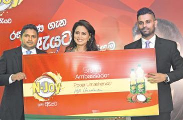 From left: Sales Manager, N-Joy, Nalaka Jayasekara, N-Joy Brand Ambassador Pooja Umashankar and Marketing Manager,   Suren Fernando at the relaunch.