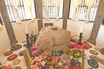 The sacred Grinding Stone displayed in the temple for public veneration