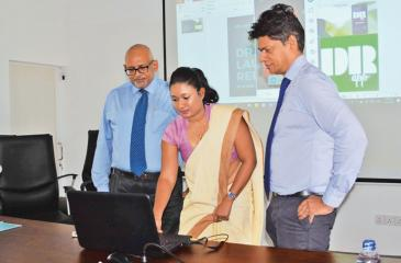 YAU Medhavi (centre) IT Officer of the Sr Lanka Anti Doping Agency launches the anti-drug App called Drug Reference App or DR App in the presence of Chairman the Sri Lanka Anti Doping Agency professor Arjuna de Silva (right) and the Director General of SLADA Dr. Seevali Jayawickrama at its auditorium